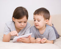Children using tablet computer Royalty Free Stock Photography