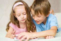 Children using tablet computer Stock Photo