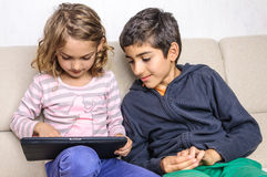 Children using tablet pc at home Royalty Free Stock Images