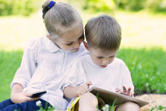 Children using a tablet PC and smartphone Royalty Free Stock Photos