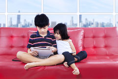 Children using tablet together Royalty Free Stock Image