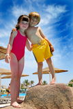 Children in vacation. Sister with brother on vacation at hotel pool Royalty Free Stock Images
