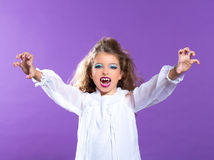 Children vampire makeup kid girl on purple stock photo