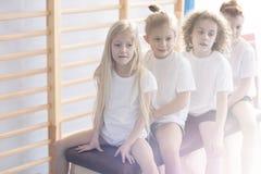 Children on vaulting box close-up stock photo