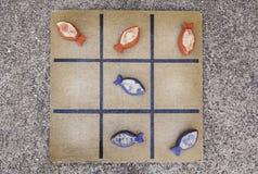 Children& velho x27; jogo de s de peixes de madeira fotografia de stock royalty free
