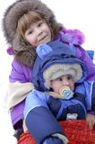 Children are very glad to a snow Stock Photography