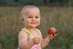 Children very much love fruit. Stock Photography
