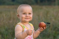 Children very much love fruit. Royalty Free Stock Photo