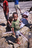 Children from the village Lamalera. People from the fishing village Lamalera, Indonesia, Lembata island, cut big fish Marilyn..The village of Lamalera on the royalty free stock photos
