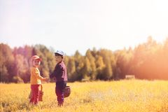 Children in the village walk through the autumn forest and gathe stock image