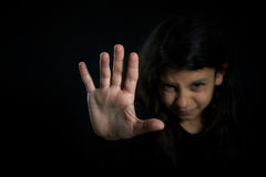 Children violence. Girl with her hand extended signaling to stop Royalty Free Stock Image