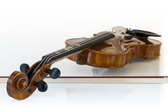 Children violin  lying on it's stick Stock Photo