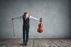 Children with violin. Musician with violin in studio stock image