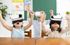 Children with virtual reality headset. In classroom Stock Photo