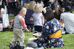 Children visit Brooklyn Botanic Garden for Cherry Blossom festiv Royalty Free Stock Photos