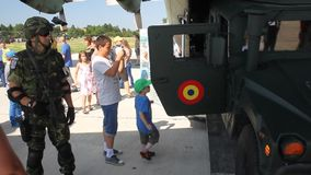Children visiting military equipment stock video footage