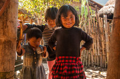 Children in Wa People's Village. This is a village called Weng'ding, located in southwest of Yunnan province. It's a Wa village. The Wa people are an ethnic Stock Images