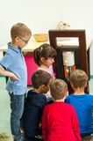Children learning about plants and oils at a workshop Royalty Free Stock Photo