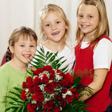Children waiting with flowers for mother royalty free stock images