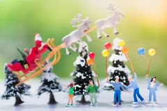 Children are waiting for a gift from Santa Cross, using as on Christmas day.  Royalty Free Stock Image