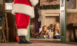 Children waiting for Santa Claus. Children sitting near fireplace and waiting for Santa Claus Stock Images