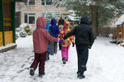 Children on walk in kindergarten in the winter. Royalty Free Stock Photo