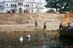 Children walk on the old stairs of the ghat Royalty Free Stock Photography