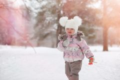 Children walk in the park in winter. Winter forest a family with royalty free stock photography