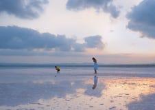 Children walk on Salty shore of the Laguna Salada de Torrevieja, Stock Photo