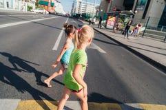 The children. Children walking around the city, the sun shines Royalty Free Stock Photo