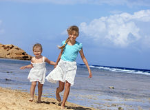 Children  walking on  beach. Royalty Free Stock Photos