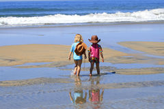 Children walking on beach stock image