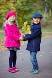 Children walking in beautiful autumn park on warm sunny fall day. Happy children walking in beautiful autumn park on warm sunny fall day Royalty Free Stock Photography