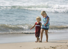 Children walking hand in hand Royalty Free Stock Photo