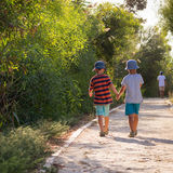 Children walking holding hands Royalty Free Stock Photography