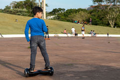 Children walking hoverboard and skate park trail Stock Photo