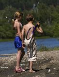 Children walking by river Stock Photos