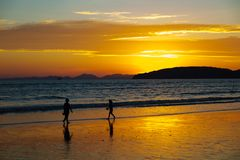 Children Walking At Beach During Sunset Royalty Free Stock Photos