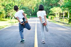Children warm up before running on the road. Color of hipster tone selective and soft focus Stock Photos
