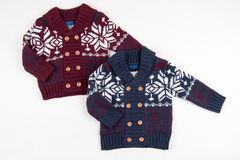 Children warm vest (sweaters) Stock Photos