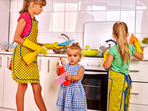 Children wash  kitchen. Royalty Free Stock Photos