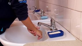 Children wash their hands with soap and water. stock video footage