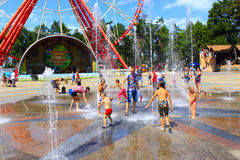 Children wash themselves in fountains of Gorky Park in Kharkiv Stock Photo