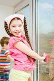 Children wash window Stock Photography