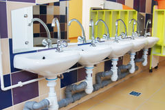 Children washbasins in a bathroom of kindergarten Stock Image