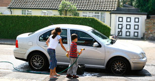Children washing the car stock images