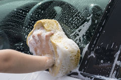 Children washing the car Royalty Free Stock Images
