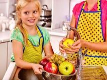 Children washing fruit at kitchen Stock Photos