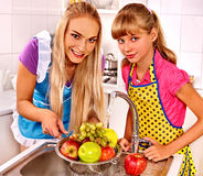 Children washing fruit at kitchen Stock Photo