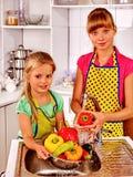 Children washing fruit at kitchen. Royalty Free Stock Photo